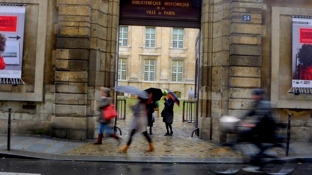 Pedestrians walking in Paris in the rain