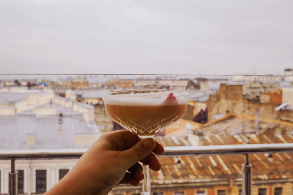 Enjoying a cocktail at a rooftop bar in St. Petersburg